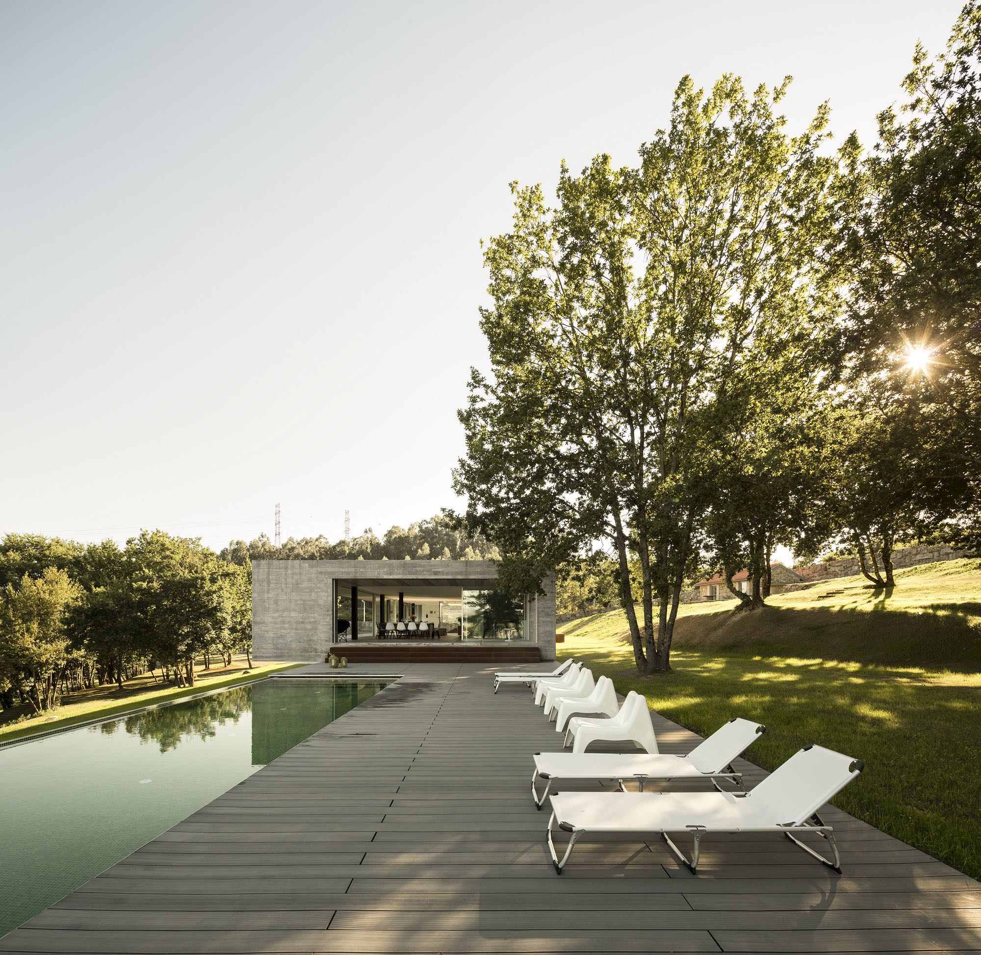 house with swimming pool and outside furniture