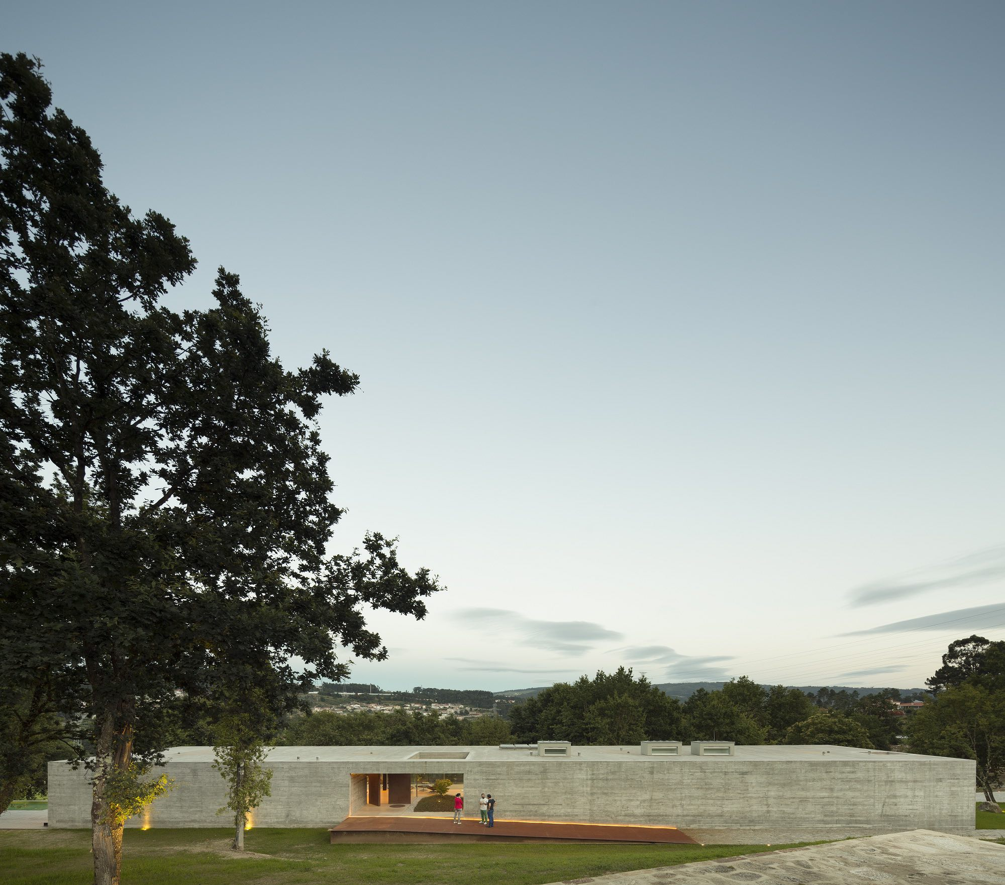 concrete house surrounded with green landscape