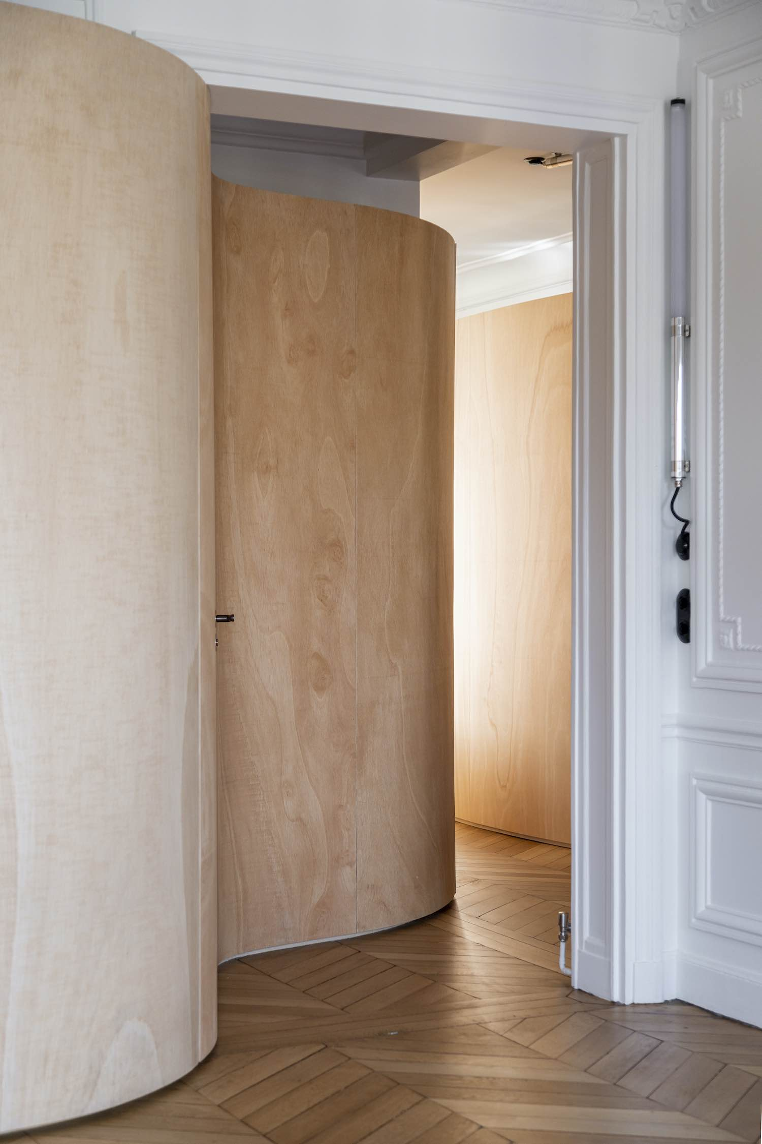 wooden wall installed in this tiny apartment in France